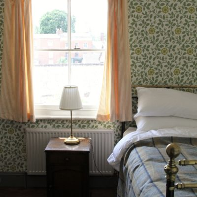 Twin bedroom with vintage style wallpaper